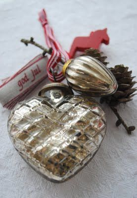 Mercury heart with red and white ribbon.
