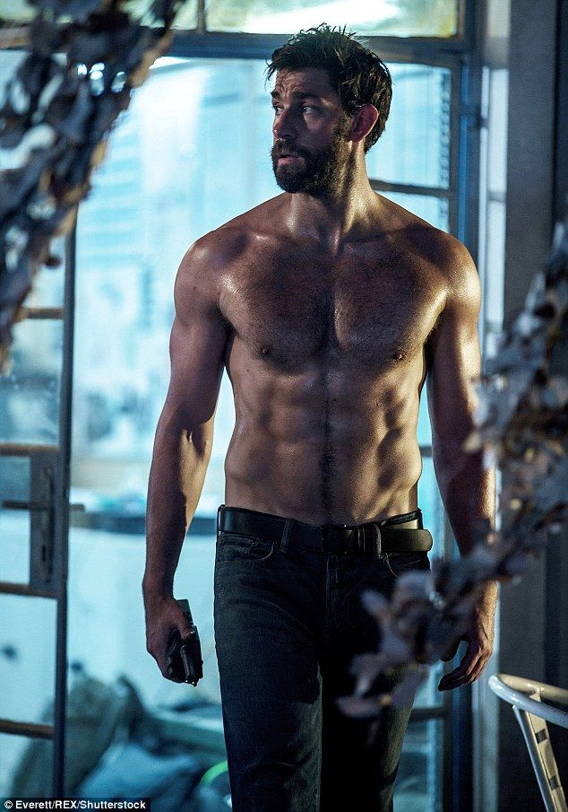 Transformation: John Krasinski says shedding the flab and gaining muscle has made him feel more confident in the bedroom with his wife Emily Blunt (pictured in 13 Hours)