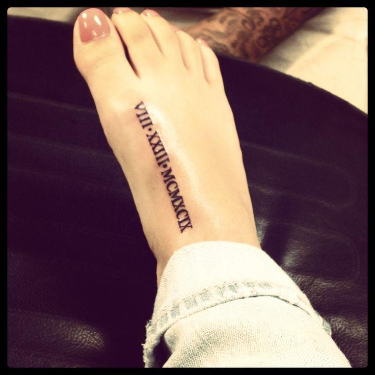 roman numeral tattoo on foot tats