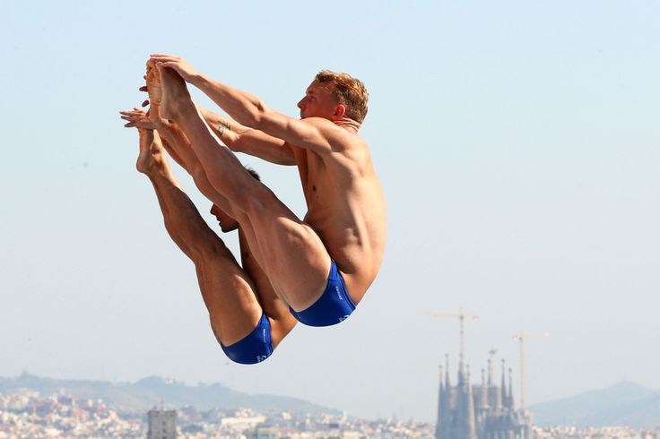 Chris Mears and Nicholas Robinson-Baker of Great Britain compete in the Men's 3m Synchro Springboard Diving preliminary round on day four of the 15th FINA World Championships in Barcelona, Spain. : Quinn Rooney/Getty Images