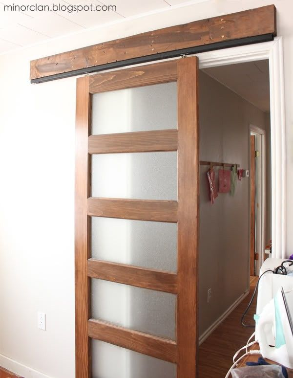 diy sliding barn door using a closet door track - via The Lettered Cottage