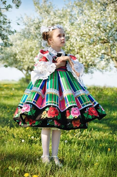 Little girl in traditional costume of Łowicz, Poland