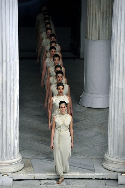 Special Olympic gymnastics athletes, in the role of ancient Greek priestesses, perform during the lighting of the 'Flame of Hope' for the 2013 Pyeong Chang  World Winter  Games at the Zappion megaron in Athens on January  17, 2012.