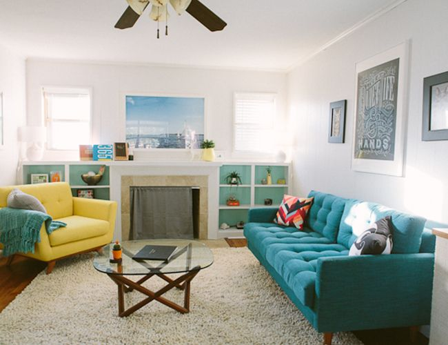 mid-century style home decor // turquoise couch + yellow chair + living room
