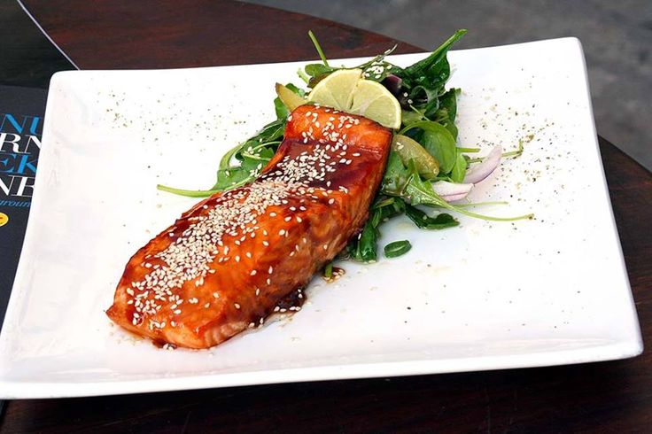 Salmon fillet baked with soy glaze and sesame garnished with green salad with capers, cucumber and lemon vinaigrette flavored with lemongrass.Paparouna Wine Restaurant & Cocktail Bar | Our dishes are ready!!!