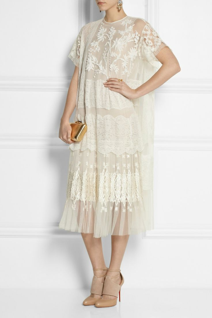 Biyan Akira floral-appliquéd tulle and lace gown  ( $2,320,  net-a-porter.com  )