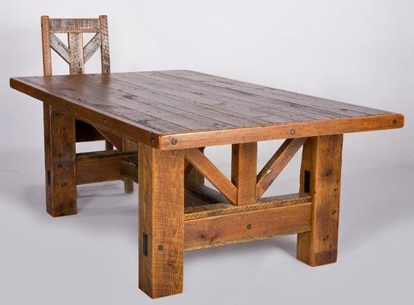 Old barn wood table with thick cross bars underneath.