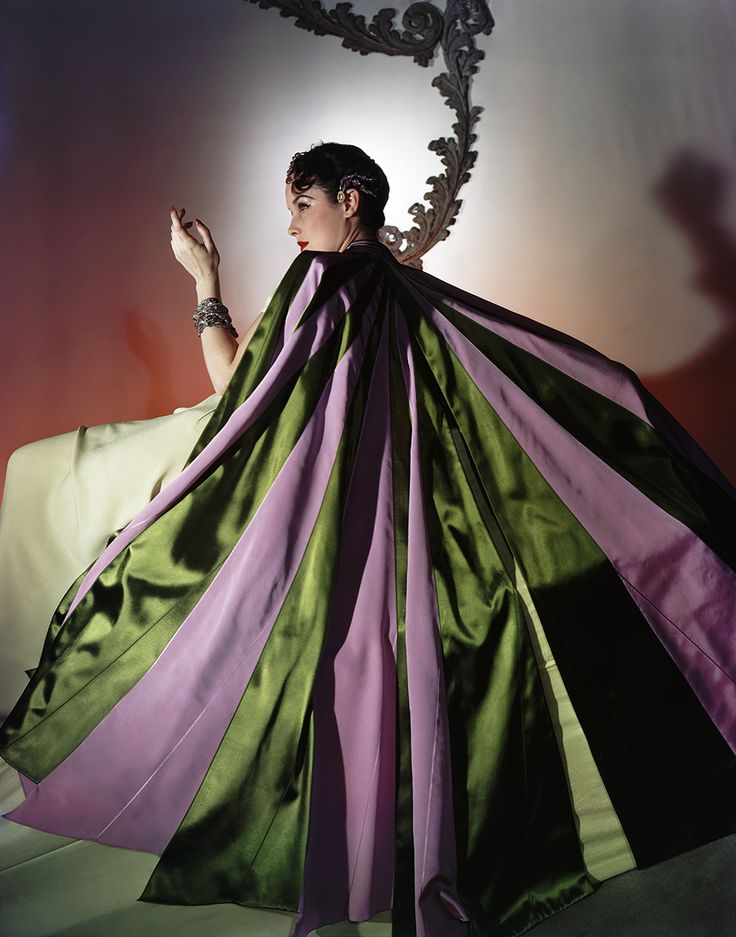 """Vogue would praise James as a """"master of color comparatives, of the cut and fold of exceptional cloths.""""  In this 1940 photograph, his """"grand-entrance evening cape . . . slit to make sweeping wings."""" #CharlesJames"""