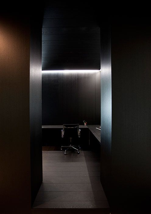 Dark wood and straight lines, the San Marino Fashion House in Belgium by Govaert & Vanhoutte _