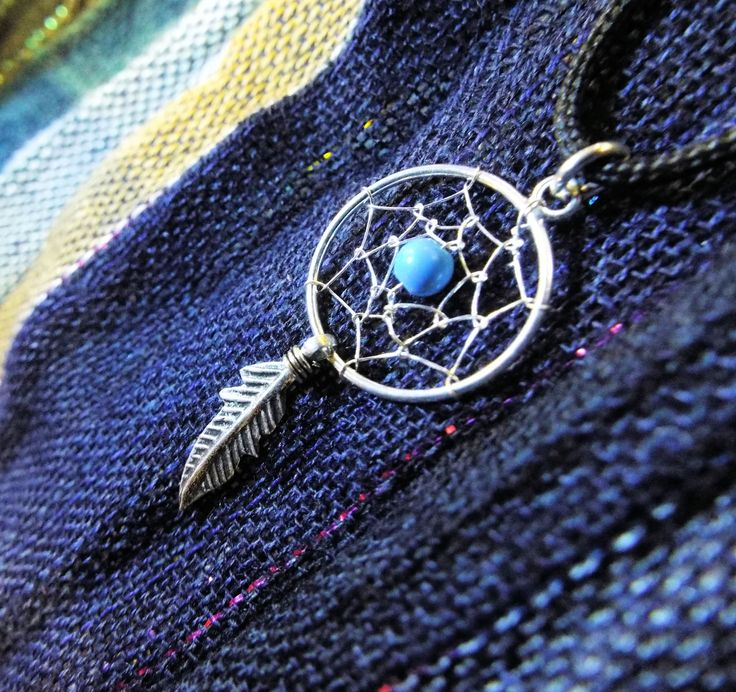 Keep the bad dreams away with this handmade sterling 925 silver dreamcatcher with turquoise for positive energy.
