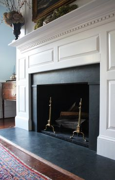 Favorite image. Really like how the material around and below the fire box are consistent. Like the simple, linear millwork. This is Virginia slate surround and hearth. Also like how the hearth extends to the outside of the wood mantle feet. Good idea to paint the inside of the fire box black.