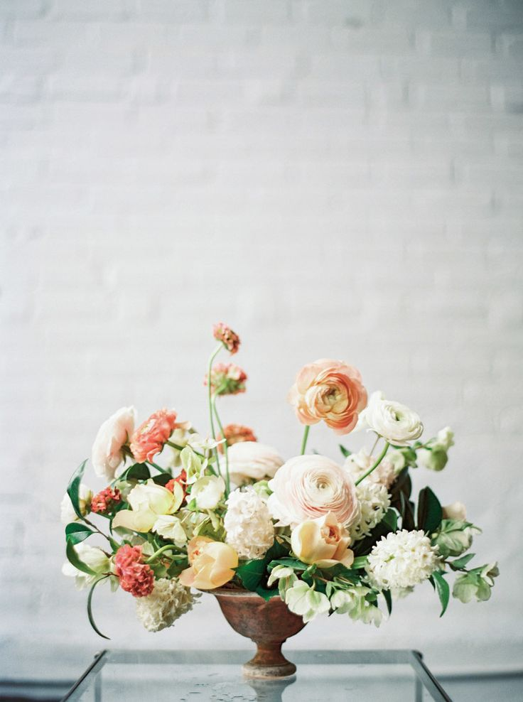 pedestal vase centerpiece, ranunculus, whites, yellows, oranges, pinks, asymetrical, garden style