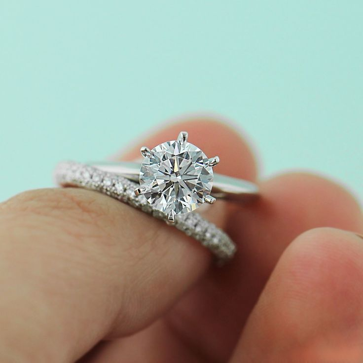 Traditional Solitaire Engagement Ring with triple micro pavé wedding band.