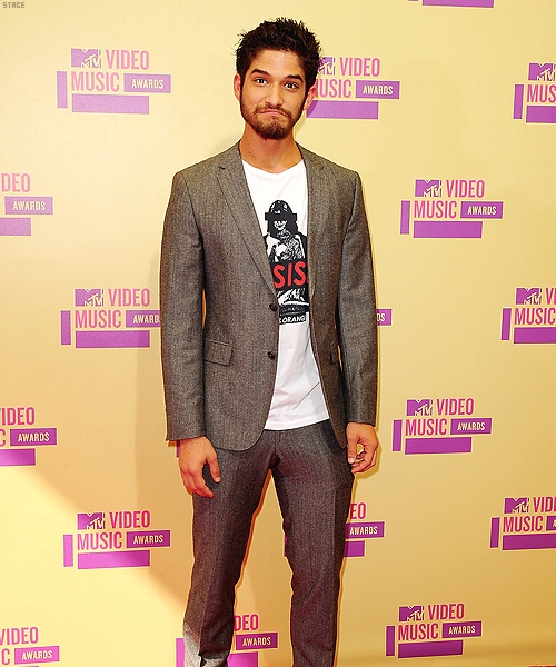 I like this look on Tyler Posey from last night's VMAs. Dressed up ...
