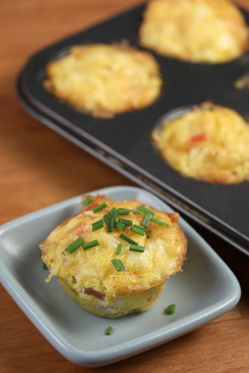 How to Bake Mini Egg Omelettes (with video)! See how a few simple ingredients (only 7) and a muffin tin pan can lead to a super easy, delicious breakfast idea.