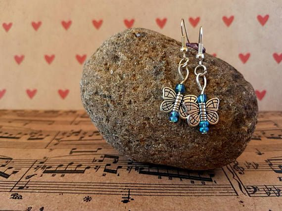 Check out this item in my Etsy shop https://www.etsy.com/au/listing/540209531/butterfly-earrings-light-blue-and-silver