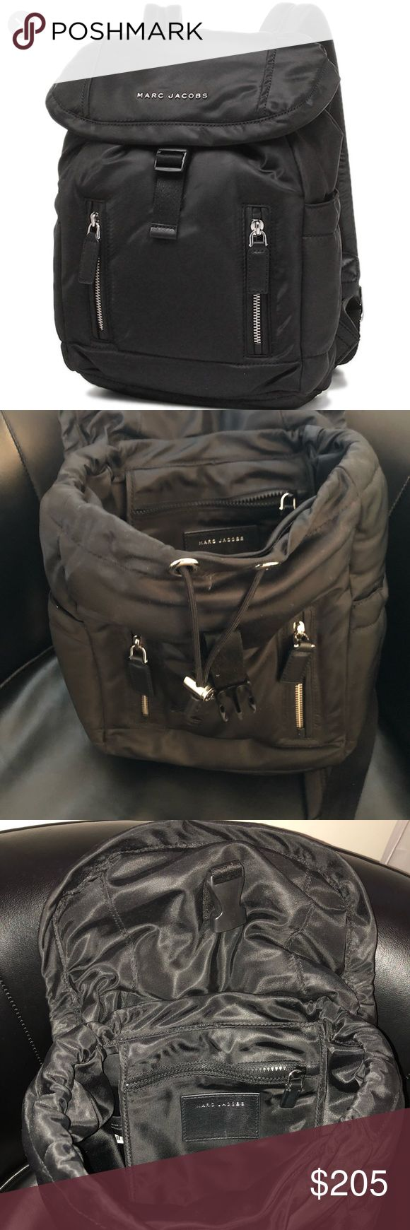Marc Jacob's Drawstring/Clip Backpack -Marc Jacob's Drawstring Backpack  -Excellent condition  -Nylon material  -Top handle -2 front zip pockets -2 side water bottle compartments  -Zip pocket inside with logo  -Drawstring gathers top and also buckles for added security  -Material is jet black but it was hard to portray in a picture Marc By Marc Jacobs Bags Backpacks