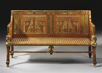AN EGYPTIAN REVIVAL MAHOGANY AND PARCEL GILT SETTEE On Female Egyptian  Monopodia Supports 54 In