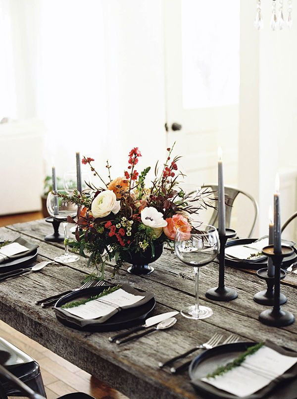 For an industrial loft wedding, add a black and white color palette for a modern rustic tablescape complete with a colorful wedding centerpiece.