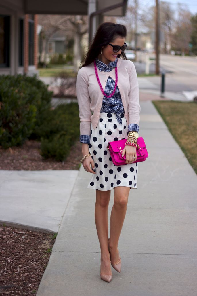 Checked shirt, pink cardi, polka dot skirt, nude shoes, pink accessories.
