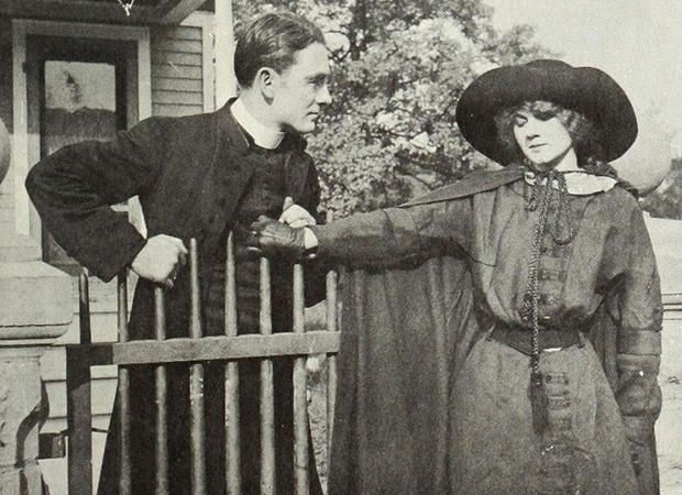 """Owen Moore is a minister and Florence Lawrence is a barkeeper's daughter in """"The Redemption of Riverton"""" (1912)."""
