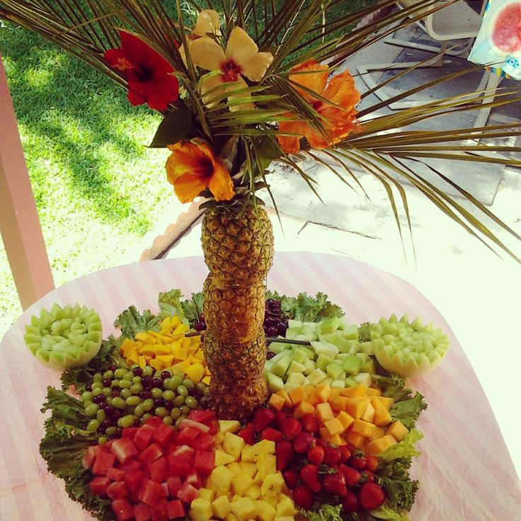 My pineapple palm tree fruit display. Added hibiscus flowers. Made this for a baby shower. -Monica