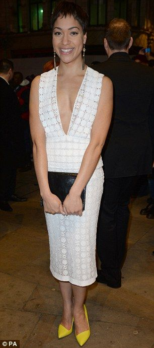 Elegant: Playwright Cush Jumbo adds some colour to her crocheted dress with yellow heels
