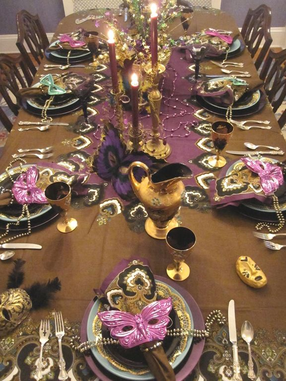 Mardi Gras table setting but use a different runner with an edging of peacock feathers.    http://oursoutherntable-jen.blogspot.com/2011/03/mardi-gras-inspiration.html