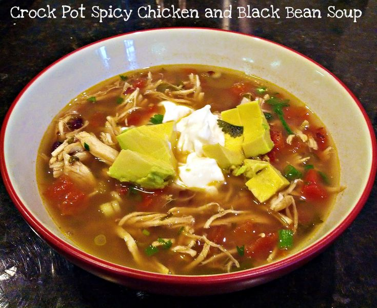 A spicy, healthy chicken and black bean soup made in the crock pot! Topped with light sour cream and avocado, still only around 300 calories for a huge bowl!