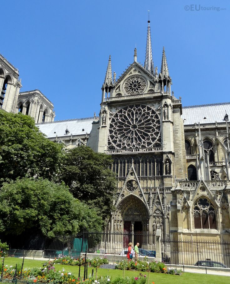 In this photo you can see the south facade of the Notre Dame Cathedral while standing the Square Jean XXIII, showing some of the neat flower beds along the grass.  You may be interested in more; www.eutouring.com/images_paris.html