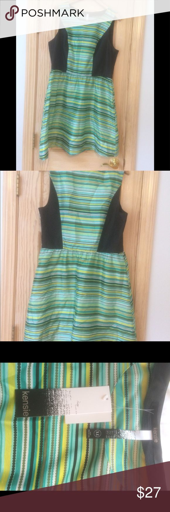 NWT Kensie Striped Party 🎉Dress This NWT Kensie for Macy's hot party dress has stripes and dots in greens, blues, yellows, and blacks. It is a dramatic statement piece Dress sure to turn heads. Kensie Dresses Midi