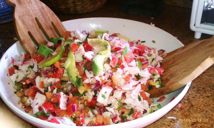 Ceviche de jaiba (crab) diced tomato, onion, jalapeno, cucumber, and freshly squeezed lime juice. Served up with tostada shells and avocado