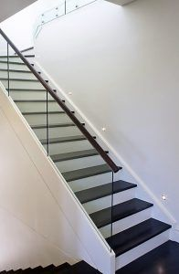 Closed rise stair with custom glass balustrade