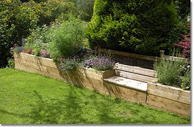 Raised planters with bench