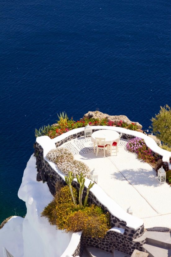 Savor a meal here........Santorini terrace, Italy