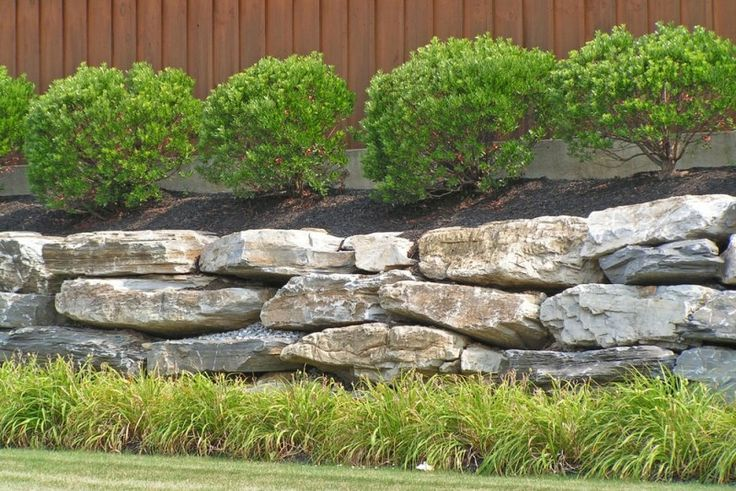 A low height slate rock retention wall for soil and plantings
