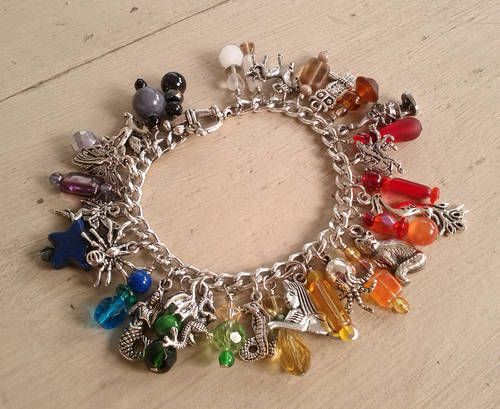 Care of Magical Creatures Charm Bracelet - One of Jennieingram's AMAZING charm bracelets. I positively have fallen in love with this style of jewelry.: That, Creatures Charm, Charm Bracelets, Charms, It S Charming, Themed Charm, Amazing Charm, Magical Creatures