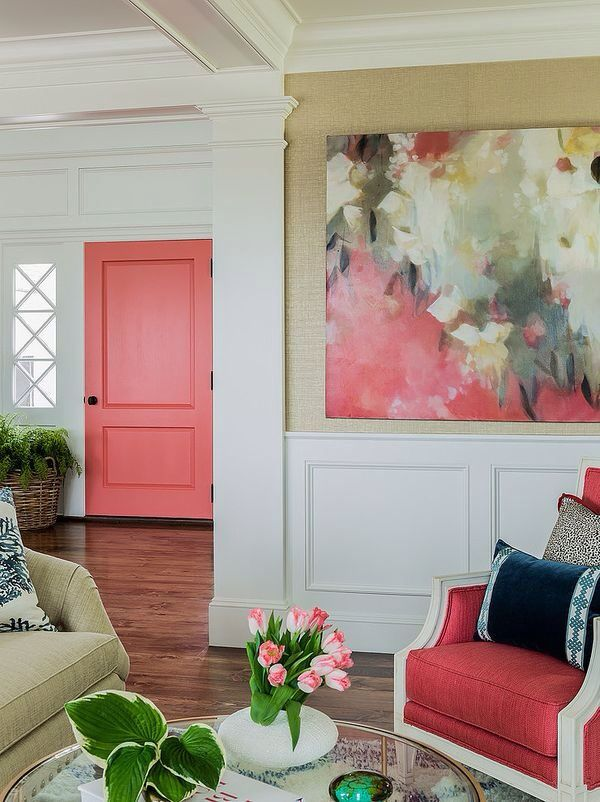 Creating an accent colour in a room adds character. It doesn't have to be the loudest colour to be confident. This coral hue is subtle yet it makes a strong statement in this room. Photo credit- honeyandfitz.com