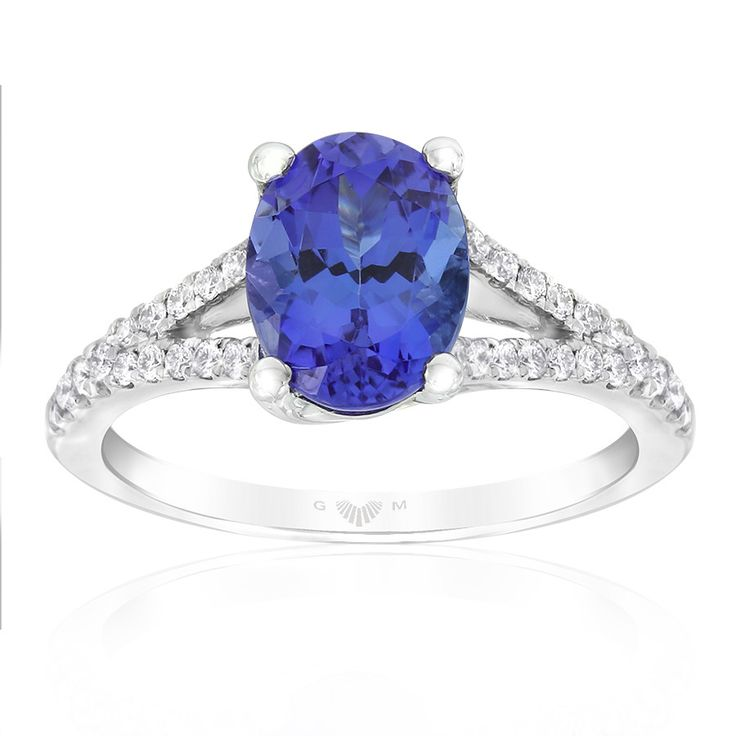 Rare and beautiful. Kilimanjaro tanzanite and diamond dress ring. This oval tanzanite weighs 1.77carats. Crafted in 18ct white gold. This ring will be customised to perfectly fit your finger, which may take up to 6 weeks