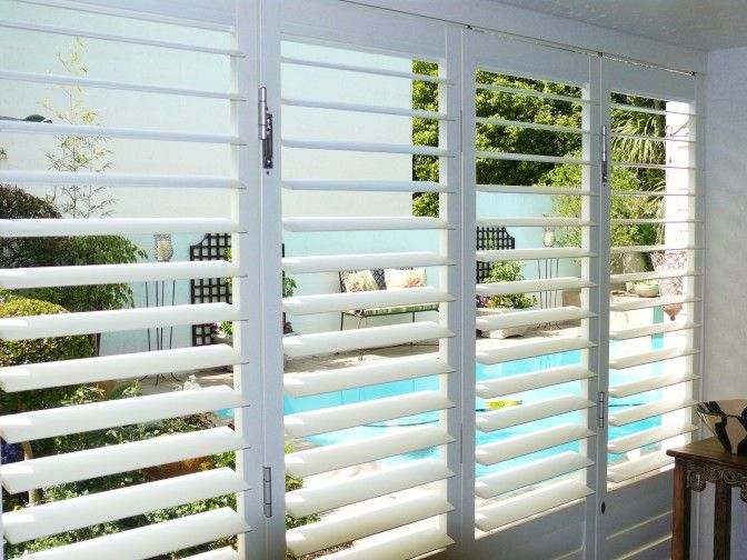 Aluminium security shutter range - also in wood look. American Shutters