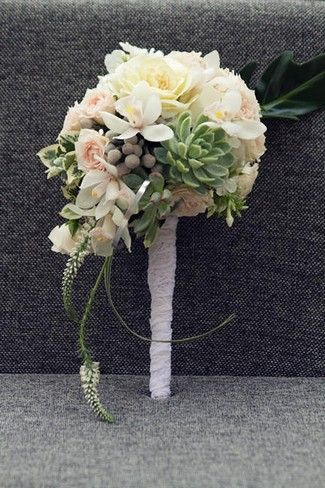 1950s Wedding Ideas | Confetti Daydreams - A lace wrapped bouquet inspired by the color palette of peach, white and gray ♥ #1950s #wedding #inspiration #ideas