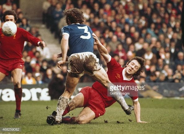 Liverpool player Jimmy Case puts in a hard tackle on Everton full back Mike Pejic during an FA Cup semi final match played at Maine Road on April 23 1977 in Manchester England