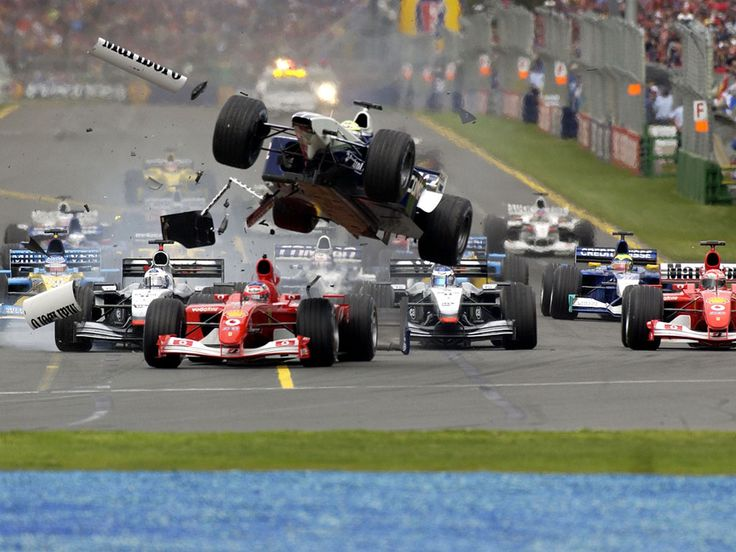 Great capture of a F-1 car being launched in the air. Thank goodness for the advancements in Safety for these drivers who push the envelope race after race.