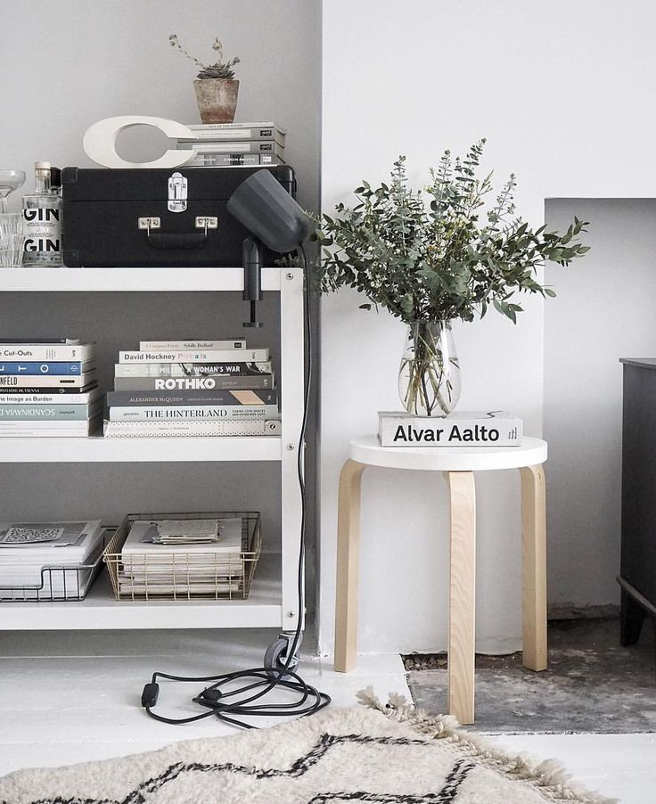 A trolley from Habitat used to display books and magazines - artek alvar Aalto stool