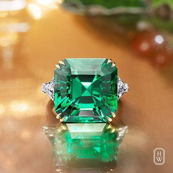 Extraordinary 16.13 carat Colombian Emerald Ring with diamond side stones. Harry Winston