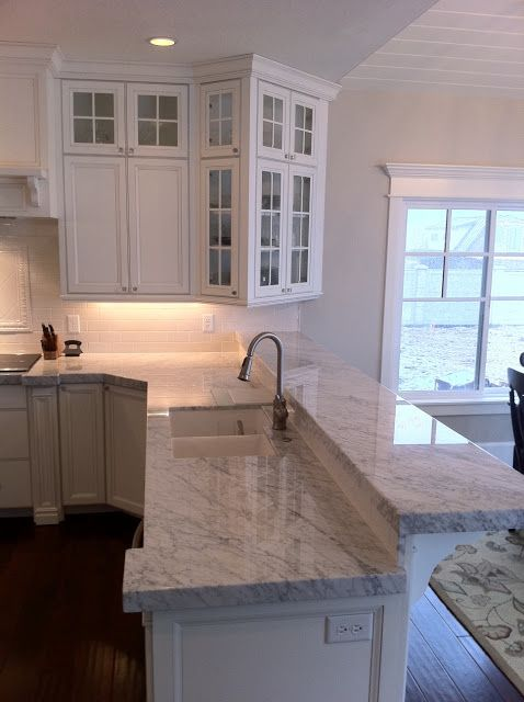 Love the countertop. Also want to consider bringing cabinets out like this instead of island.