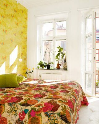 Down and Out Chic: Interiors: Floral Bedspreads (love the light in this room)