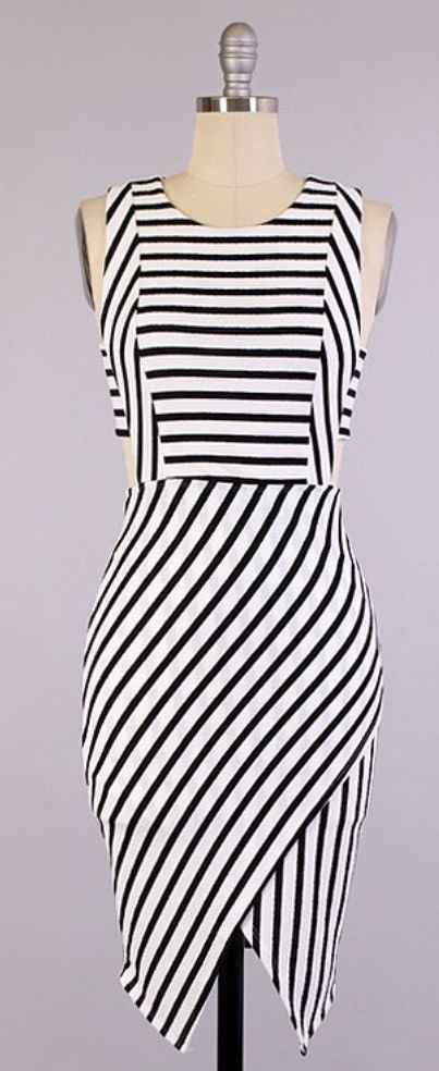 Black and white stripe dress features side cut outs and zipper back. 65% Rayon 35% Polyester Please allow 1 week to ship