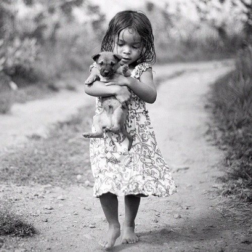 Indonesian girl with puppy