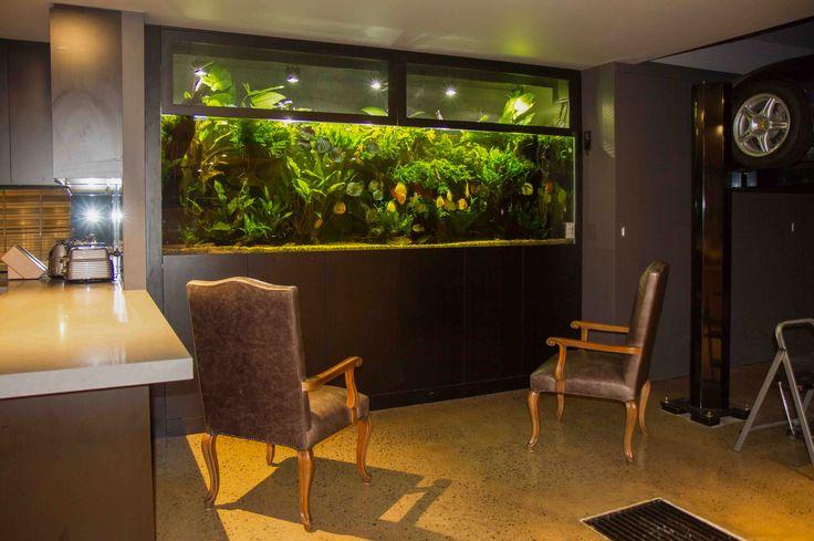 Garage/Basement with theater, aquarium, kitchenette and hydraulic car lift. www.thekitchendesigncentre.com.au @thekitchen_designcentre